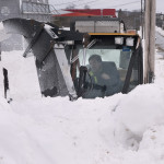 Shawn Toupin with Brewer Public Works clears snow from the sidewalks on Feb. 15 in Brewer.
