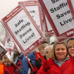 Nurses picket in the front of Eastern Maine Medical Center along State Street in Bangor in 2010.