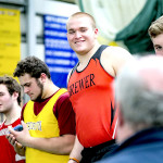 Brewer's Austin Lufkin smiles as he's recognized for his record-breaking performance in the shot put.  