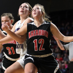 Katahdin's Georgia Landry (12) and Southern Aroostook's Kacy Daggett get positioned to grab a rebound during Monday's Class D North girls quarterfinal at the Cross Insurance Center in Bangor.  Joseph Cyr