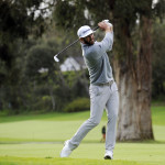 Dustin Johnson hits on the seventeenth hole fairway during the final round of the Genesis Open golf tournament at Riviera Country Club.
