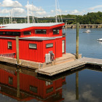 The bright red houseboat owned by Steve White is docked at the Front Street Shipyard in Belfast, Aug. 20, 2014.