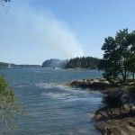 Firefighters from several communities traveled by boat to Sheep Island in the New Meadows River for a large woods fire. Many small Maine communities depend on volunteer firefighters.