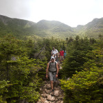 Hikers make their way down the Saddle Trail after reaching the summit of Mount Katahdin.