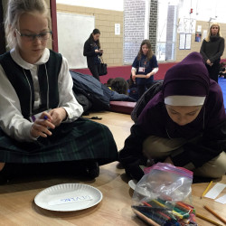 Students from Sacred Heart Academy, Bernard Zell Anshe Emet Day School and Muslim Community Center Academy gather for an interfaith event sponsored by Poetry Pals, a nonprofit youth arts organization.