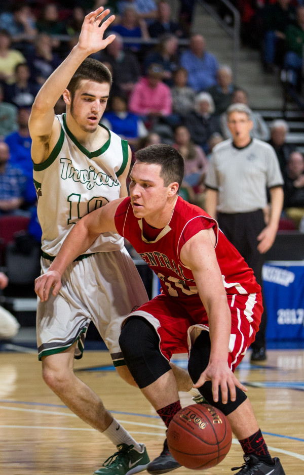 Central's Andrew W. Speed (right) tries to dribbles past Mount Desert Island's Andrew Phelps during their boys class B semifinal game at the Cross Insurance Center in Bangor on Wednesday afternoon.