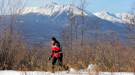 A lone skier enjoys a cross-country skiing trail at the Katahdin Woods and Waters National Monument. Gov. Paul LePage has asked President Donald Trump to rescind the executive order that created the monument.