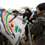 Oscar High Elk, 26, of the Cheyenne River Sioux Tribe prays as he and other members of the tribe prepare to evacuate from the main opposition camp against the Dakota Access oil pipeline near Cannon Ball, North Dakota, Feb. 22, 2017.