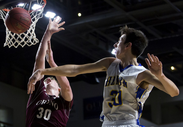 Hermon's Isaac Varney (right) fouls Orono's Connor Robertson during their Class B boys basketball semifinal game at the Cross Insurance Center in Bangor Wednesday.