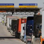 Trucks wait in a long queue for border customs control to cross into the U.S. at the Otay border crossing in Tijuana, Mexico, Feb. 2, 2017.