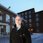 Developer Paul Boghossian stands outside the Hathaway Creative Center in Waterville in 2013.