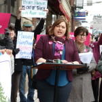 Andrea Irwin, executive director of the Mabel Wadsworth Center, speaks Thursday outside the office of U.S. Rep. Bruce Poliquin in support of continued funding for Planned Parenthood.