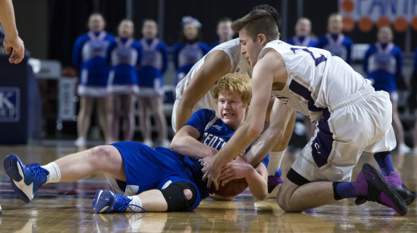 Central Aroostook's Ben Thomas (left) battles for a rebound with Southern Arroostook's Jackson Mathers during their Class D boys basketball semifinal game at the Cross Insurance Center in Bangor Thursday.