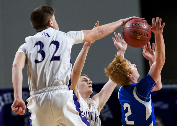 Southern Arroostook's Nolan Altvater (left) blocks a shot from Central Aroostook's Ben Thomas during their Class D boys basketball semifinal game at the Cross Insurance Center in Bangor Thursday.