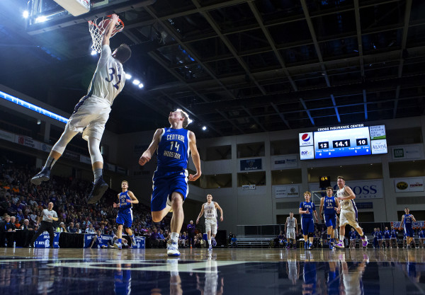 Southern Arroostook's Nolan Altvater (left) slams a dunk past Central Aroostook's Brayden Bradbury during their Class D boys basketball semifinal game at the Cross Insurance Center in Bangor Thursday.