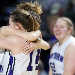 Southern Arroostook's Makaelyn Porter (left) celebrates with Kacy Daggett after defeating Easton during their Class D girls basketball semifinal game at the Cross Insurance Center in Bangor on Thursday.