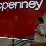 Customers ride the escalator at a J.C. Penney store in New York, Aug. 14, 2013.