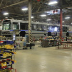 A Massachusetts Bay Transportation Authority bus being serviced can be seen on Sept. 28, 2016, at the Maine Military Authority's facility at the Loring Commerce Centre in Limestone.