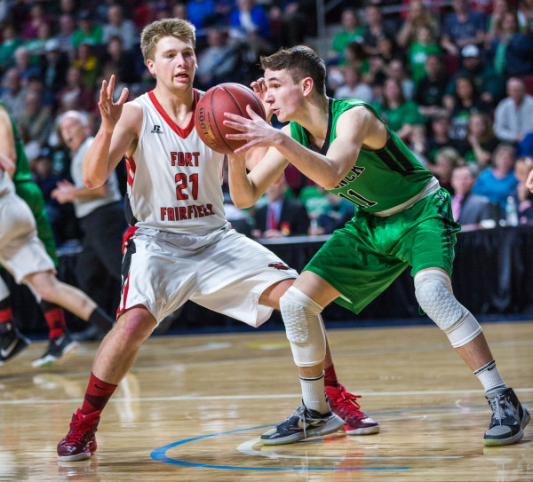 Fort Fairfield's Landen Kinney (left) defends Schenck's Colby Hannan during their class C boys semifinal game at the Cross Insurance Center in Bangor on Friday afternoon.