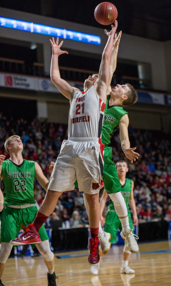 Fort Fairfield's Landen Kinney (front) battles for a rebound against Schenck's Dylan Danforth (behind) while Justin Thompson looks on (left) during their class C boys semifinal game at the Cross Insurance Center in Bangor on Friday afternoon.
