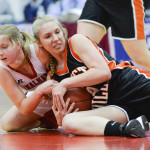 Vinalhaven's Ashleyn Littlefield fights with Forest Hills' Caitlin Logston over the ball in the first quarter of the Class D Regional Final Saturday at the Augusta Civic Center. The Vinalhaven Vikings won 61-45 over the Tigers.  