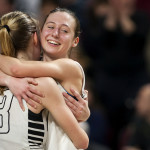 Houlton's Kolleen Bouchard (left) embraces Rylee Warman after defeating Foxcroft Academy during their Class B girls basketball championship game at the Cross Insurance Center in Bangor Saturday. Ashley L. Conti | BDN  