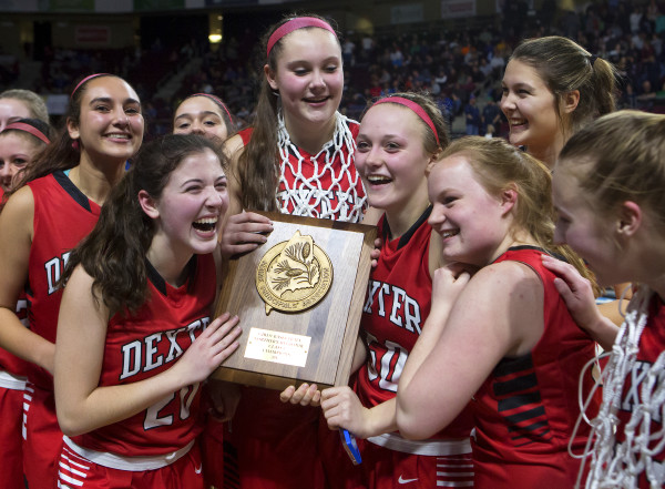 Dexter celebrates after defeating George Stevens Academy during their Class C girls North basketball championship game at the Cross Insurance Center in Bangor on Saturday.