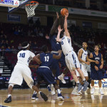 Andrew Fleming of the University of Maine (right), pictured during a Jan. 19 game in Bangor, scored 17 points and grabbed nine rebounds on Saturday in the Black Bears' 72-71 win at Binghamton University.
