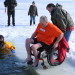 Mike Noyes, a member of the Camp CaPella board of directors, hauled in the most money at an estimated $2,000 during the camp's Polar Dip fundraiser at Phillips Lake on Sunday. This year's event brought in a record-breaking $14,000.