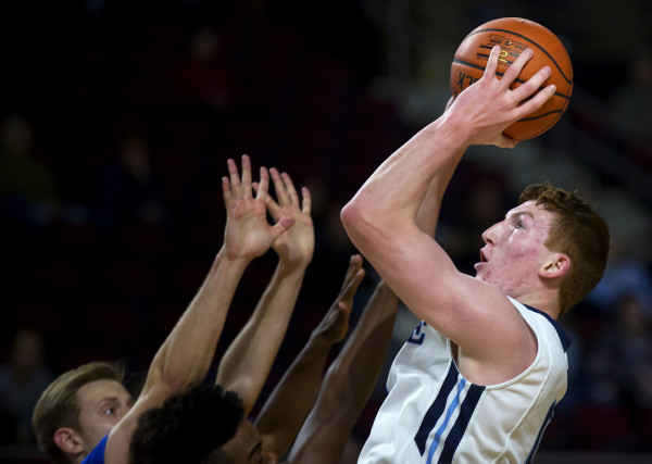 Andrew Fleming of the University of Maine (right) goes up for a shot during a December 2016 game. The freshman from South Paris on Monday was named to the America East All-Rookie Team.