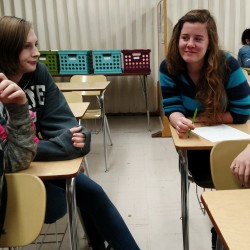 Sophomores at Telstar High School in Bethel on Monday brainstorm questions they'll ask community members about how they define community. From left, Selina Creelman, 15, of Bethel; Stephanie Geyer, 17, of Bethel; Georgia Piawlock, 15, of Bryant Pond; and Alexis Sing, 16, of Bryant Pond.