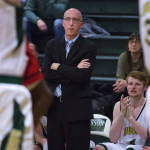 Husson University head coach Warren Caruso watches as his team faces Thomas College during their basketball game at Newman Gym in Bangor on Jan. 10, 2017.
