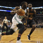 Boston Celtics forward Jae Crowder (99) drives to the basket as Atlanta Hawks guard Tim Hardaway Jr. (10) defends during the first half at TD Garden in Boston.