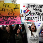 People participate in a protest march calling for human rights and dignity for immigrants, in Los Angeles, Feb. 18, 2017.