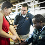 Students Sindy Godoy Escobar (left) and Stephan Tchoupou work with instructor Paul Froman at a Southern Maine Community College EMT training course designed especially for new Mainers in South Portland on Thursday. The class is designed to give immigrants an opportunity to learn English language interpreting skills while becoming state-certified emergency medical technicians.