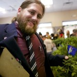 Paul McCarrier of Medical Marijuana Caregivers shows a cannabis plant at the Home Grown Maine Medical Marijuana Trade Show in 2014.