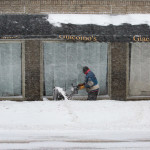A man snowblows the sidewalks along Central Street in downtown Bangor on Monday morning. Blizzard conditions left over a foot of snow on some sidewalks and low visibility for pedestrians and cars alike.