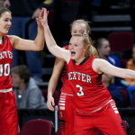 Dexter's Cidney Pratt (right) high fives teammate Dexter's Rebecca Batron after defeating Madawaska during their Class C girls basketball quarterfinal game at the Cross Insurance Center in Bangor Tuesday.
