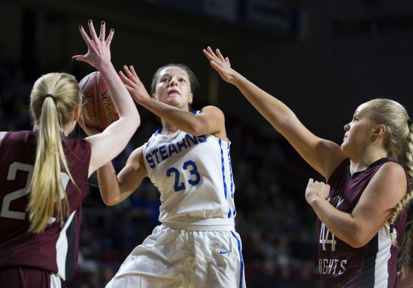 Stearns' Emma Alley (center) tries for two past Narraguagus' Kayla Toppin (left) and Narraguagus' Kaci Alley during their Class C girls basketball quarterfinal game at the Cross Insurance Center in Bangor Tuesday.