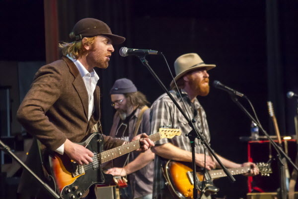 "Will (left), Wally (center) and Luke Mallet of the Mallett Brothers Band perform their new album ""The Falling of the Pine&quot at Stearns High School in Millinocket last Saturday. The album evolved from an encounter with the book ""Minstrelsy of Maine: Folk Songs and Ballads of the Woods and the Coast,"" and is comprised from lyrics from the book, set to newly arranged music."