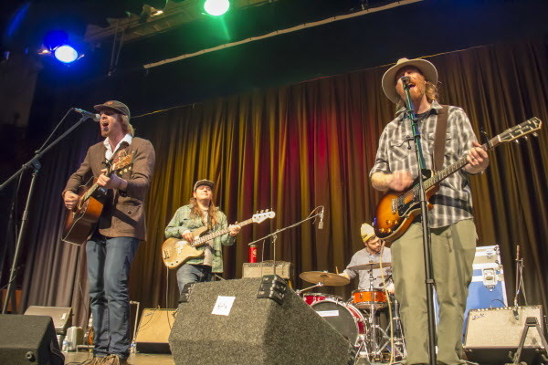 "Will Mallett (from left), Nick Leen, Chuck Gagne and Luke Mallett of the Mallett Brothers Band perform their new album ""The Falling of the Pine&quot at Stearns High School in Millinocket last Saturday."