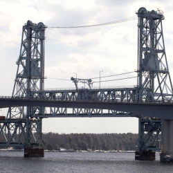 The Carlton Bridge is seen behind the Sagadahoc Bridge from the Bath waterfront on March 11, 2015.