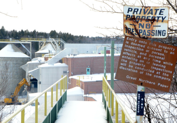 East Millinocket leaders hope that the razing of one of four buildings at the former Main Street paper mill site would not scare off a developer interested in purchasing the property.