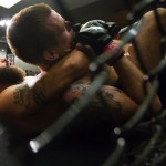 "Derrick Kenington (left) tries to submit Young's MMA's Ryan Sanders during their lightweight bout as part of the reality program ""Dana White: Lookin' For A Fight"" event at the Cross Insurance Center grand ballroom in Bangor, Aug. 5, 2016."