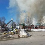 Firefighters worked to extinguish a blaze at the Winthrop post office Tuesday morning.