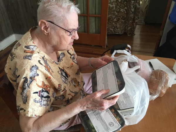 Dottie Ham, 80 of Bangor, looks over her delivery from the Meals on Wheels program, administered in the Bangor area by Eastern Area Agency on Aging. The meals are prepared locally, frozen and delivered by volunteers, who also check up on clients' welfare.