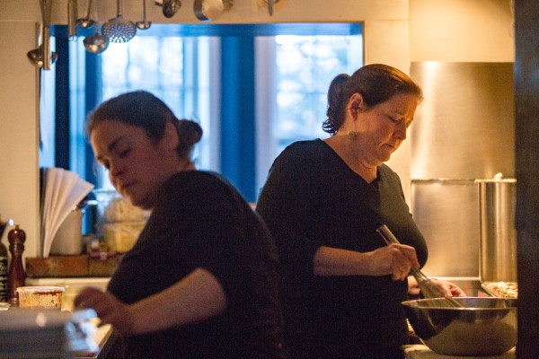 Melody Wolfertz (right), owner and chef of Rockland restaurant In Good Company, prepares for a Finland-inspired dinner at her restaurant on Friday with her sous-chef. For nearly 10 years, In Good Company has hosted Food Journeys, a series of dinners themed to a different cuisine, historical period or special event each week in the winter and spring months.