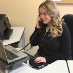 Bethan Malcolm, regional ombudsman with the Maine Long Term Care Ombudsman Program, works the phone on behalf of one of her clients.