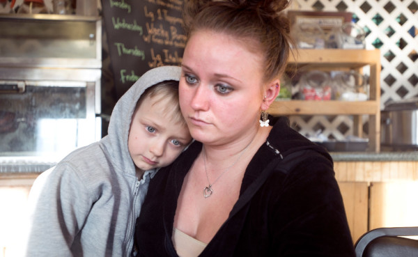 Khrystal Lynn O'Neil and her son 7-year-old Brian pause for a moment while talking about Kadhar Bailey, Khrystal's former fiancee. Bailey and Ambroshia Fagre were fatally shot by police on the Arnold Road in Vassalboro on the Feb. 10. Officers fired at the pickup truck they were in after Bailey rammed it into a police cruiser, according to police.