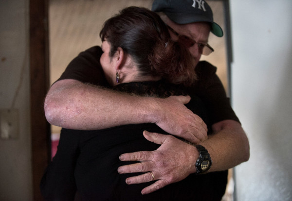 Jessica Fagre is hugged by her father Robert Robar at her Oakland home on Monday. Her daughter, 18-year-old Ambroshia Fagre, who was fatally shot by police on Feb. 10. Ambroshia was a passenger in a vehicle driven by Kadhar Bailey who also was killed. Officers, who were investigating reported burglaries in the area, fired at the pickup truck the two were in after Bailey rammed it into a police cruiser, according to police.